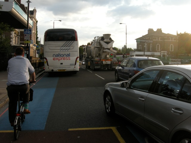 An example, further east on CS2. This is not a cycle lane; only a 'guide stripe' within a vehicle lane. The woman died while cycling on this design.