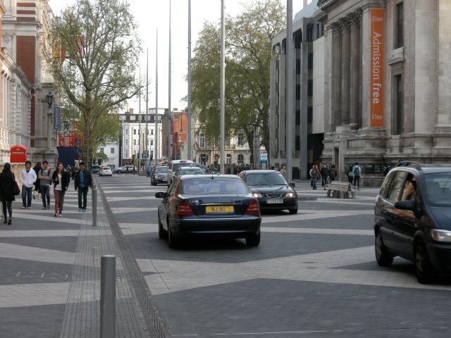 The benches can be seen on the right, in the pedestrianised area well away from the 'road'