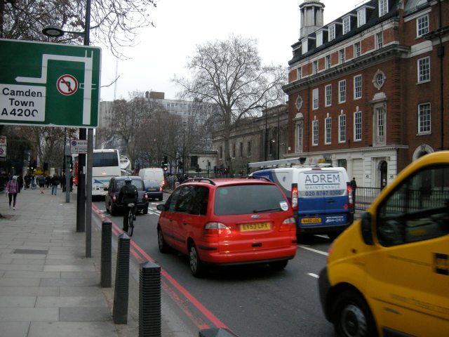 This cyclist will not be able to turn left at the approaching junction