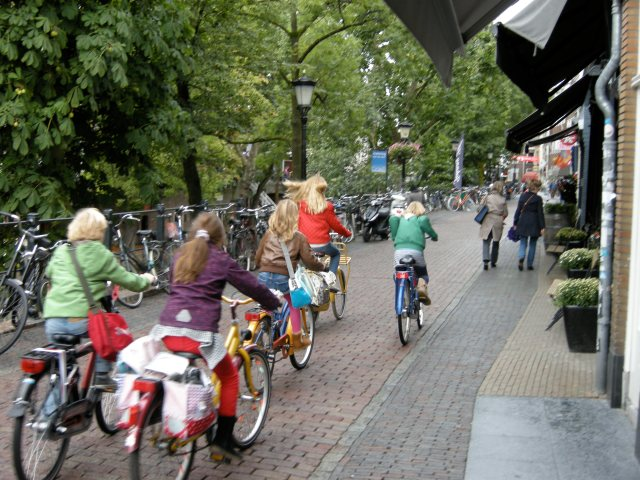 Young girls cycling into the city centre, after school - in complete safety