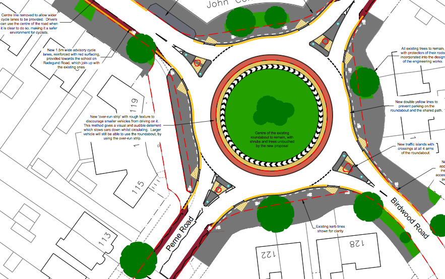 Cycle across the roundabout if you're confident; shared use pavements if you're not.