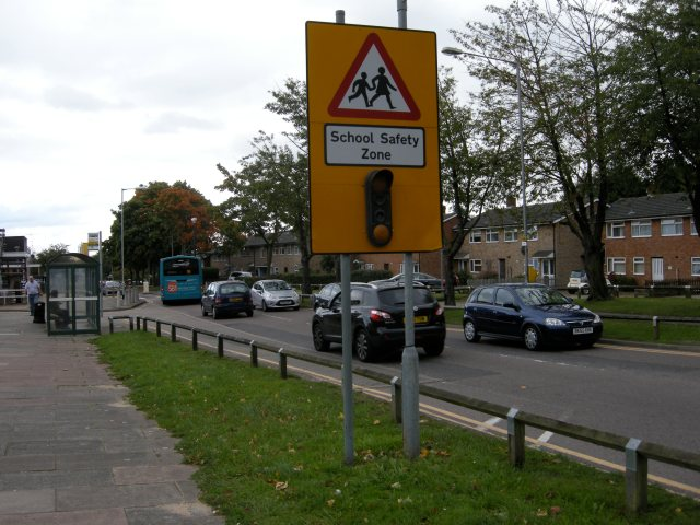 The school run in Stevenage. 'Possible' for a child to cycle on this road, but how many parents would let their their children do so?