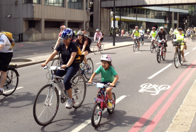 Cycling on Upper Thames Street during last year's RideLondon event. You can tell by the little girl's expression that this is fun!