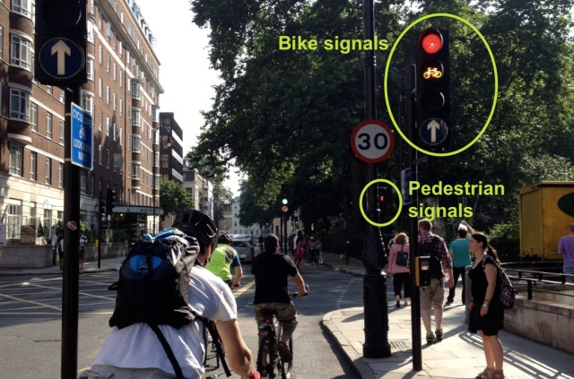 Tavistock Place cycle track, with signals, running parallel to separate pedestrian crossing