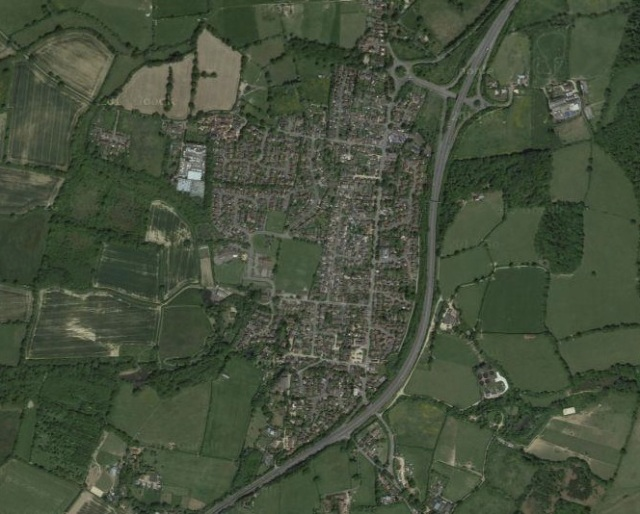 The A24 now skirts Ashington, on a dual carriageway. You can see its old route, straight through the village itself