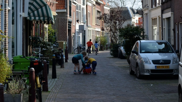 Another Dutch city-centre street, this time in Gouda. A calm oasis for children to play in.