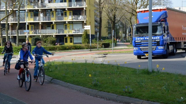 Children cycling on a roundabout, with physical separation from HGVs, Wageningen, NL