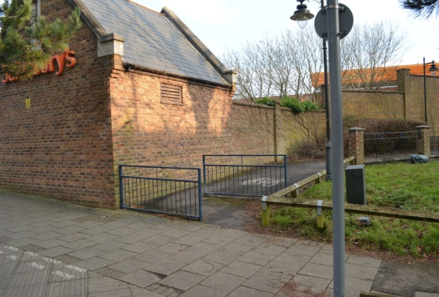 And another one. Design a cycle path right next to a brick wall, creating a blind corner? Of course. Then add barriers to solve the problem.