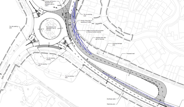 The new road in the darker grey, built to take the junction away from the roundabout.