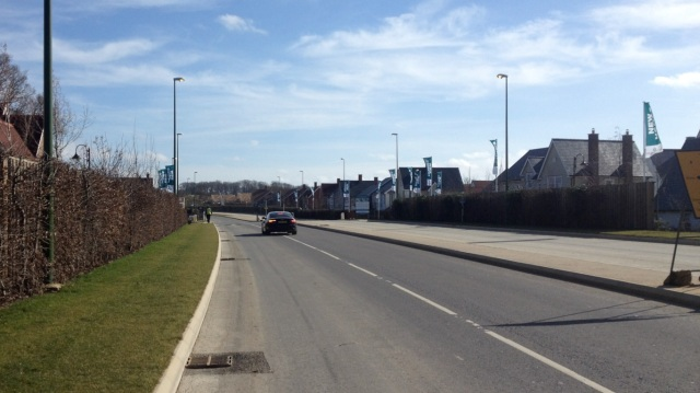 No footpath, or cycle path. This is not the middle of nowhere - this road (as can be seen) runs through new housing.