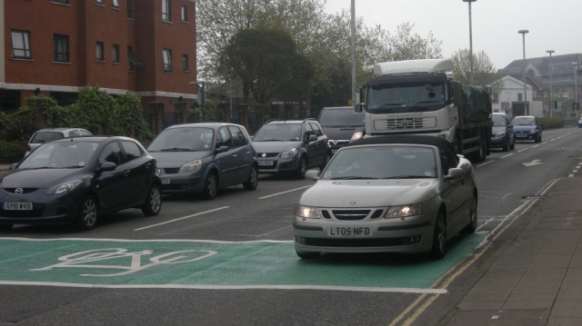 Just manoeuvre across to lane three, and stop in front of that car, before the lorry arrives.