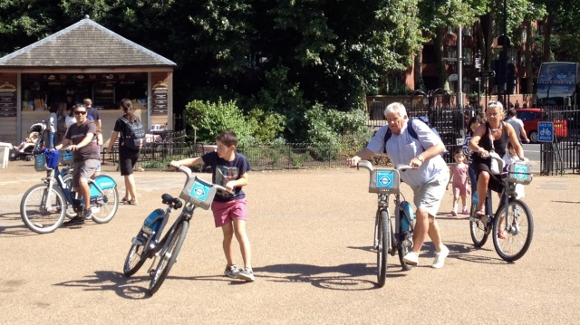 Ordinary people, using bikes, in Hyde Park