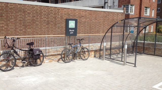 The final insult - useless bike parking, which is (of course) placed as far away from the entrance as possible