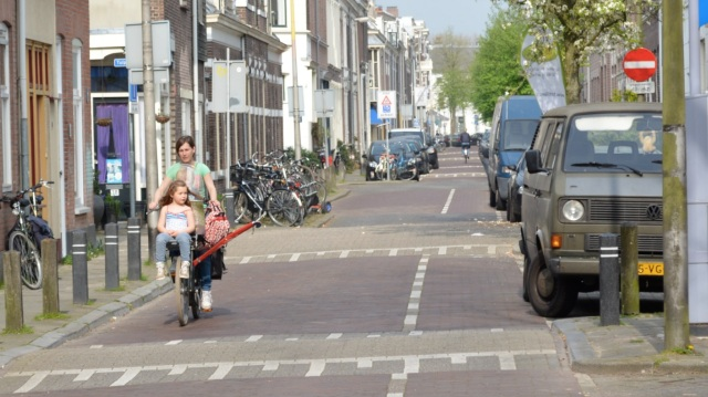 Residential street in Utrecht; motor traffic can access this street, but careful arrangement of one-way flow means it cannot be used as a through route