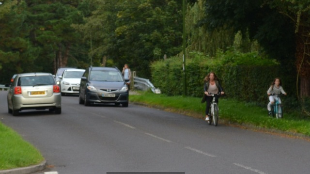 Hills Farm Lane. Again, cycling 'on carriageway' is the route here. This child is cycling in a verge, not even on a footway.