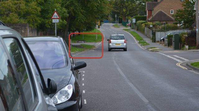 The 'jug handle' arrangement, highlighted. But to get to it, you are already have to cycle in the middle of the road, past these parked cars