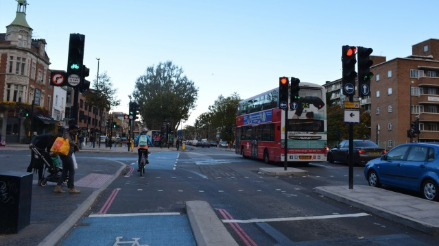 Left-turning motor traffic is held, while cycle traffic progresses through the junction, along with motor traffic progressing ahead.