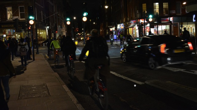 People walking, cycling, and driving, in black