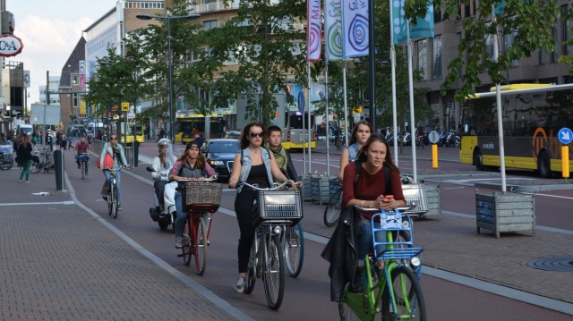 Public transport, walking and cycling on one street in Utrecht. The Dutch are free to choose the mode of transport that suits their needs for a given journey.