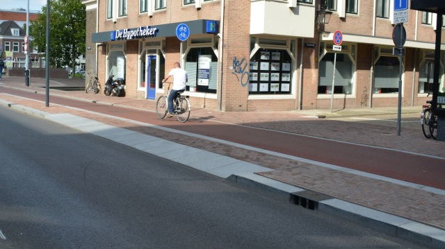 Beautifully built, with good kerbing, visually distinct from the footway,, and with no loss of priority, or merging, at junctions.