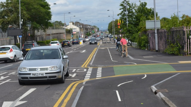 Double yellows, the green paint and the kerb line all remove any visual continuity and priority for cycling