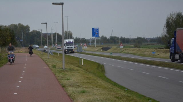 Trucks travelling at 80kph on the right; a father with children in a cargo bike, far to the left. These two should not be combined, for very obvious reasons