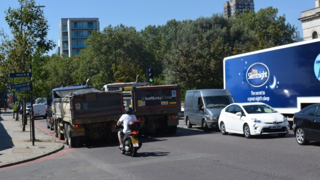An unsafe cycling environment. Humans mixed with heavy vehicles travelling at high speed.