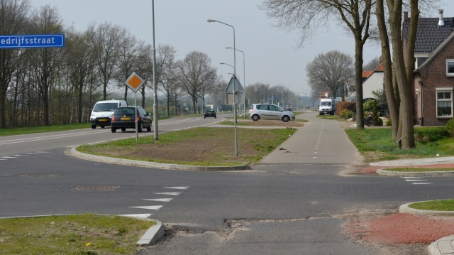 Another photograph of a priority crossing alongside an 80kph road, so new it is still under construction!