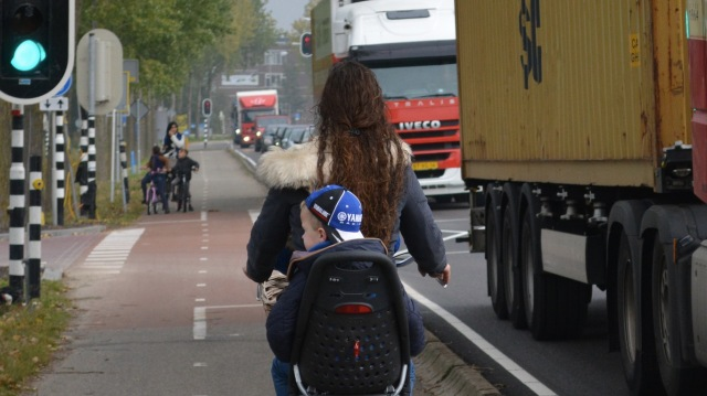 The young children on the left not equally responsible to the HGV drivers on the right